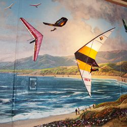 Custom wall mural of paragliders over the beach