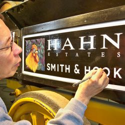 Painting a custom sign for Hahn Estates