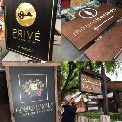 Installation of wooden signs by Signs by Van