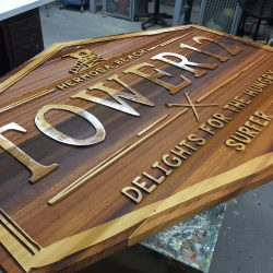 Custom wooden sign with gold leafing