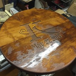 Wooden sign with engraving in production
