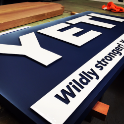 Completed custom wood sign in shop