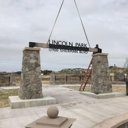 Installation of Lincoln Park Metal Sign