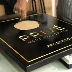 Creation of Prive Metis Real Estate sign