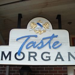 Close up of the custom winery sign for Taste Morgan