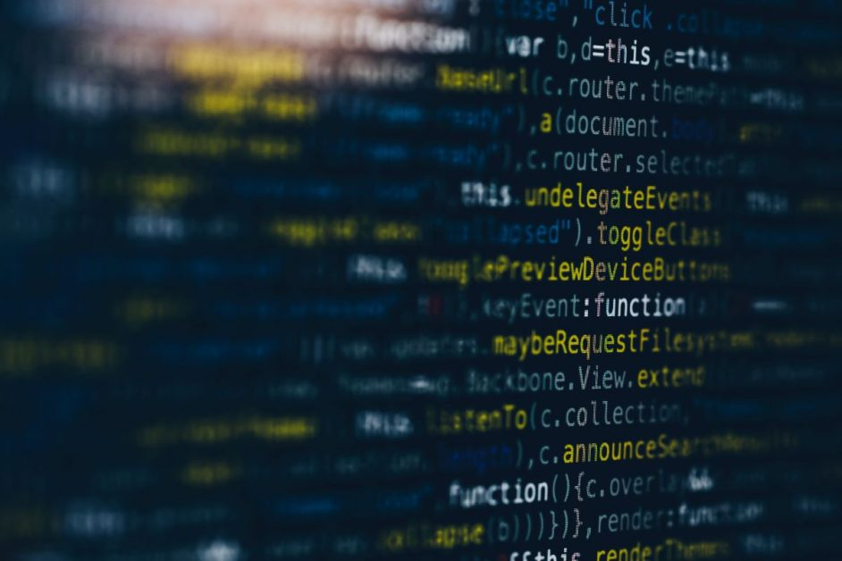 A close-up photo of computer code on a black monitor. Photo by Markus Spiske for Unsplash.