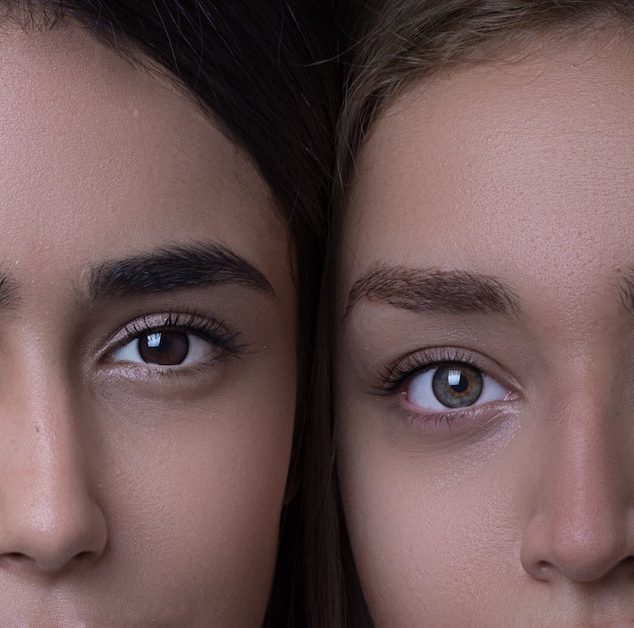 A portrait of two women's faces positioned side by side. Photo by Hadis Safari on Unsplash.