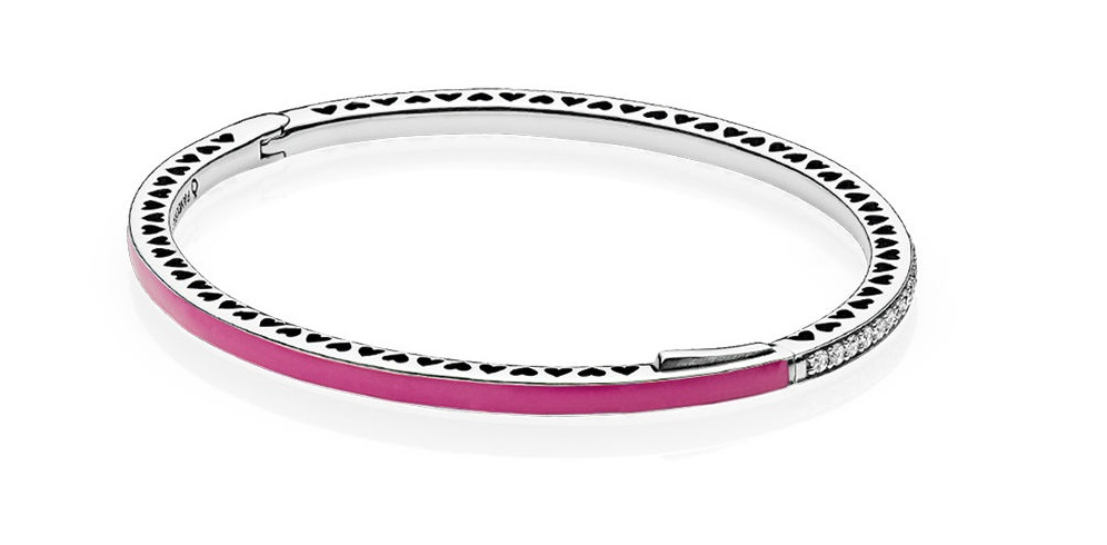 f552cac0b Shimmering stones combine with smooth fuchsia enamel to design a trendy mix  of materials. Romantic miniature hearts are cut out to complete the bangle  ...