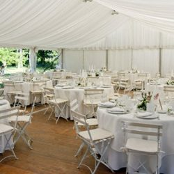 Party rentals including tent, table, and chairs - Skyline Event Rentals