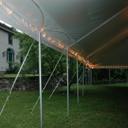 Tent rental at night with lights - Skyline Event Rentals