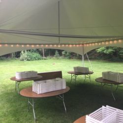 Tent rental with tables and folding chairs - Skyline Event Rentals