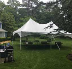 A single tent rental in a yard - Skyline Event Rentals