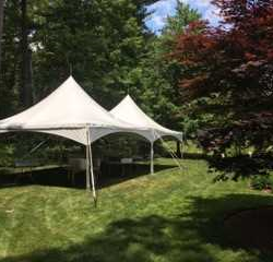 Tent rentals in a yard - Skyline Event Rentals