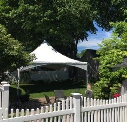 Party rental tent in a backyard - Skyline Event Rentals