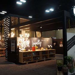 Black and white striped trade show booth