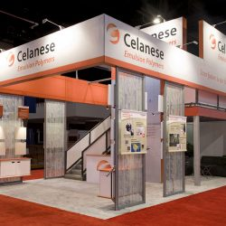 Orange and white exhibition booth with frosted glass panels