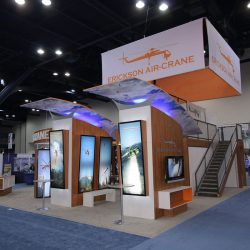 Exhibition booth with hanging banners