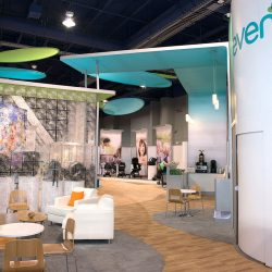 Teal and white exhibition booth with frosted glass bricks