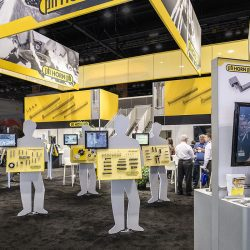 Yellow exhibition booth with hanging banners