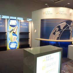 A blue and white exhibition booth designed and build by Skyline E3.