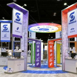 Circular, multi-colored trade show booth with hanging banners