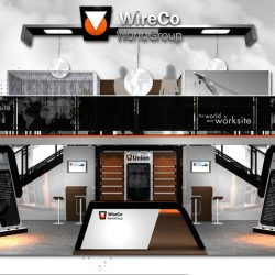 Sleek black, orange, and white exhibition booth with two levels