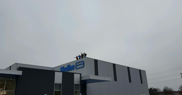 Some of the staff at Skyline E3 standing on top of their building.