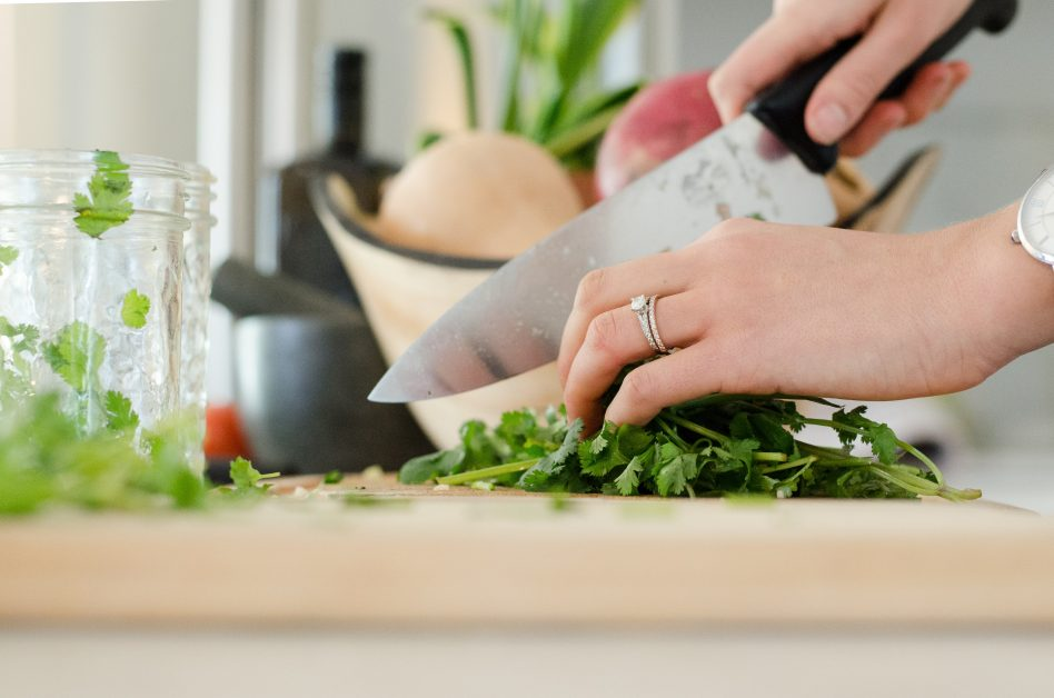 An image of a person chopping vegetables.