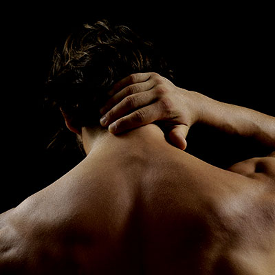 man holding neck and is in pain