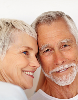 Dentures & Implants Can Restore Your Smile