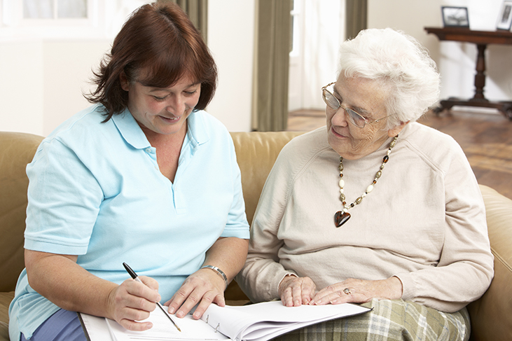 Discussing-in-home-care-with-a-senior-woman-5b2aef0d3dfa2