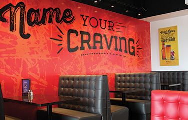"Wall with ""Name Your Craving"" slogan from Soda Jerks location"