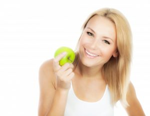Woman eating apple.