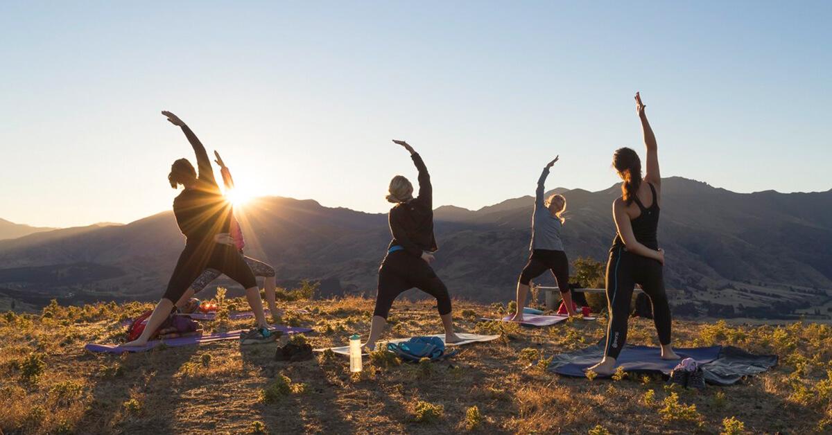 Women Doing Yoga Sunrise