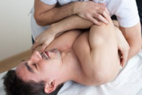 Man being adjusted on back