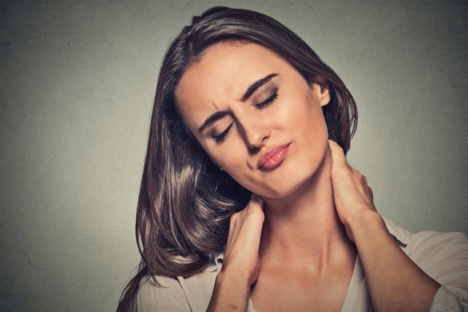 Woman grabbing neck in pain