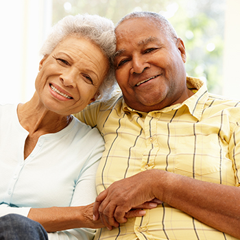 Older male and female couple happily embracing