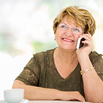 Older woman smiling and talking on phone