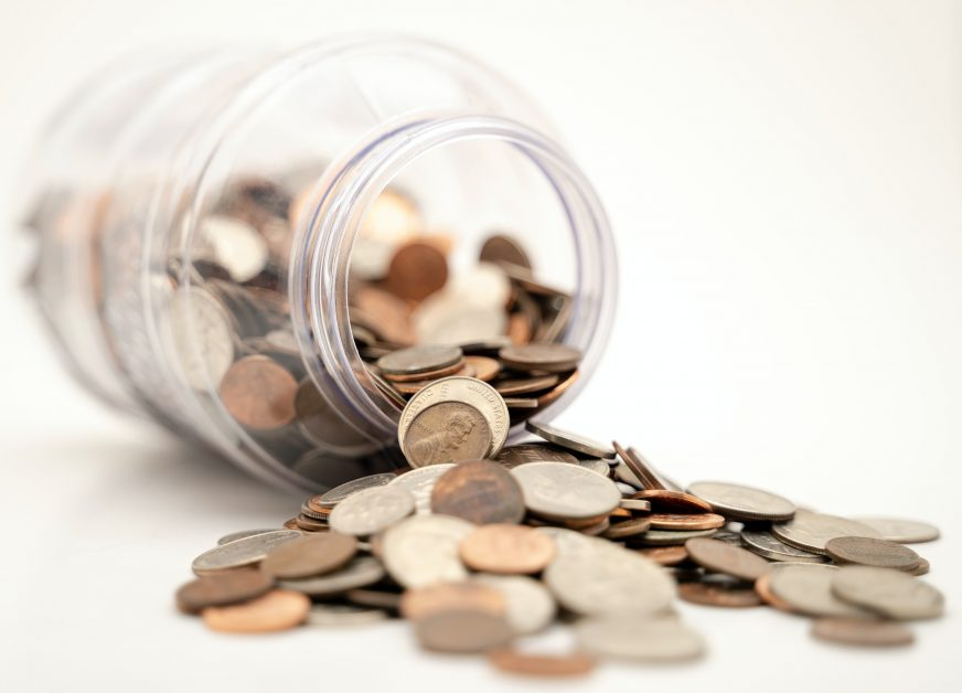 An image of a jar on money.