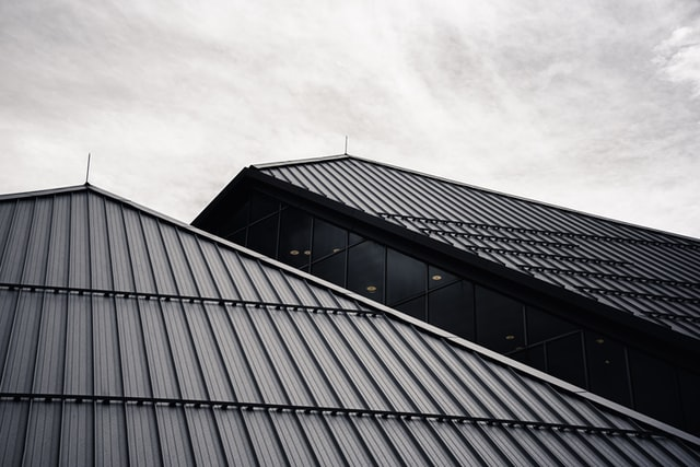 Cloudy sky with metal roof