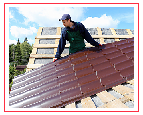 Image of a roofing contractor installing a metal roof.