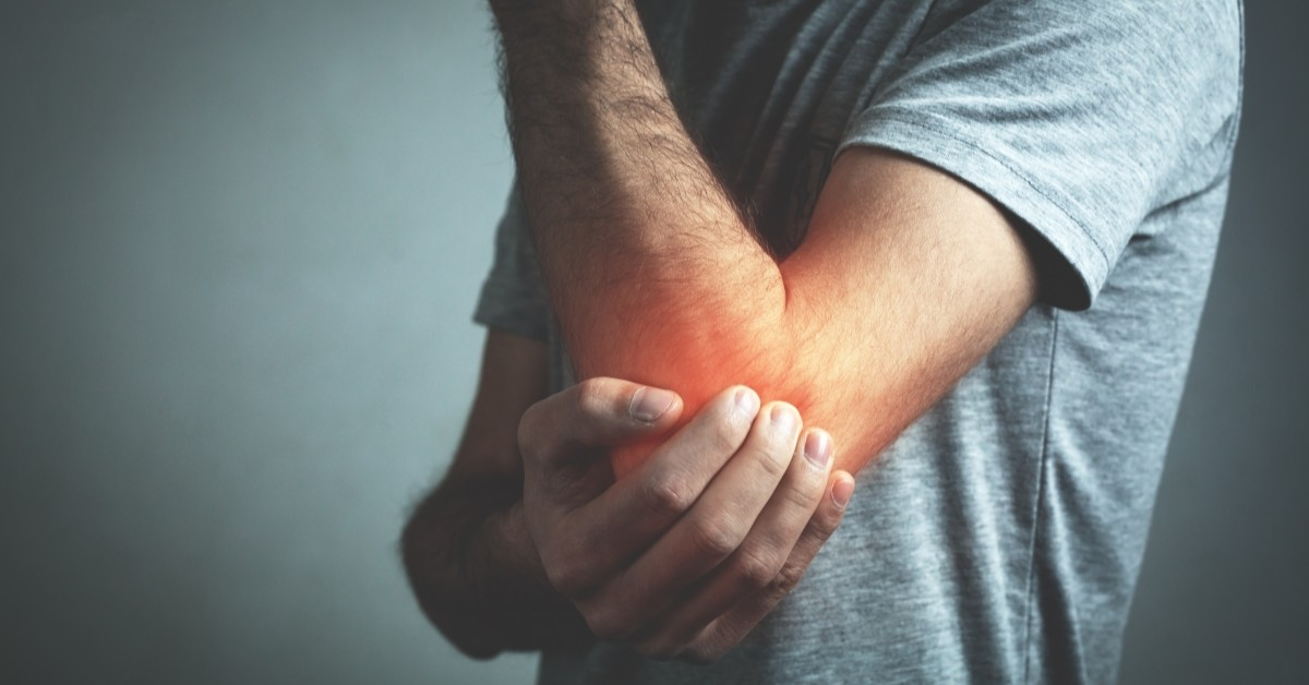 Man clutching his album in pain