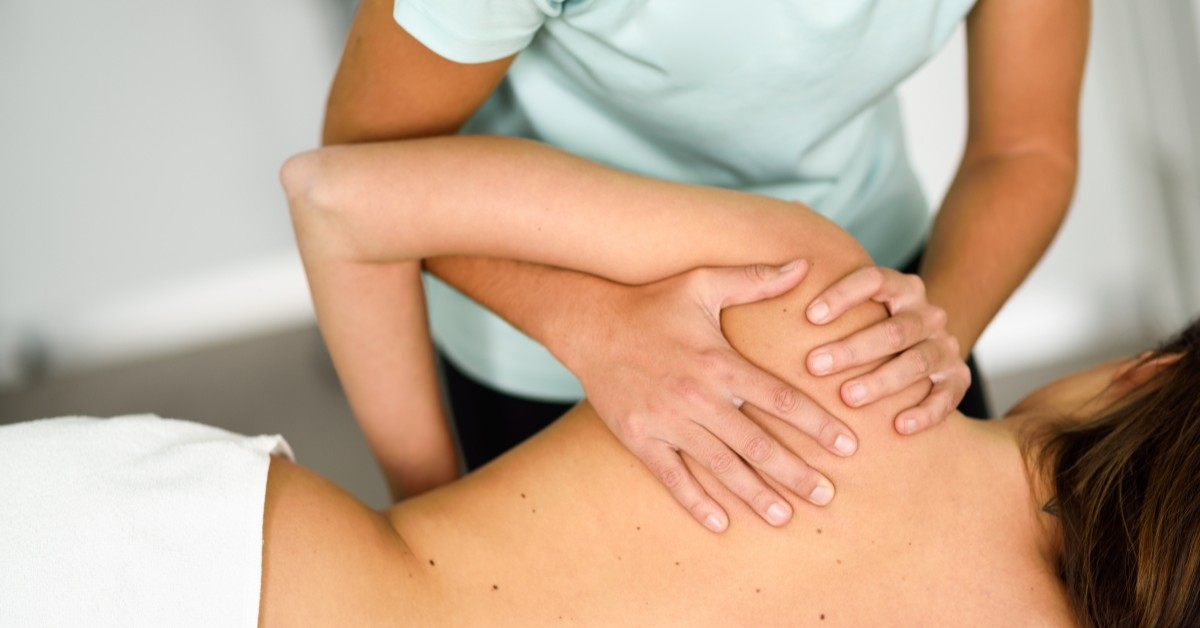 Chiropractor giving a patient a massage.