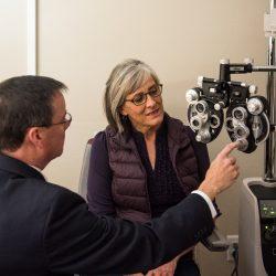 Woman in eye doctor's office during an eye exam - Spectrum Eye Care