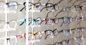 Rows of colorful glasses on display at the optometrist.