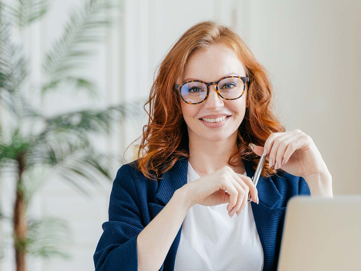 Woman wearing a new pair of prescription glasses from the eye doctor.