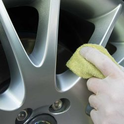 Full service auto detailing includes cleaning the rims.
