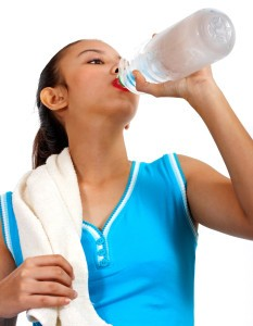 Thirsty Girl Drinking Water After Doing Lots Of Aerobics Exercise