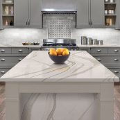 Custom gray cabinets with white island and wood floors - St Croix Cabinet Solutions