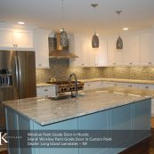 Kitchen with light blue island and white custom cabinets - St Croix Cabinet Solutions